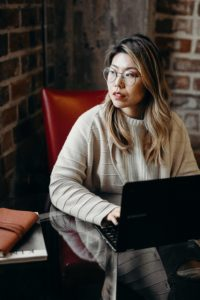 woman looking away from computer for eye health