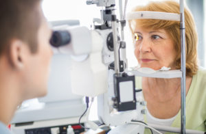 Senior caucasian woman having her eyes examined at the optician