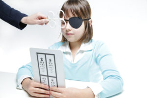 young girl doing at-home vision test
