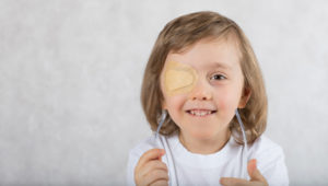 child with eyepatch for lazy eye correction
