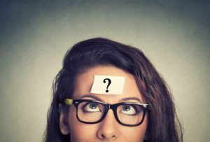 woman with question mark on forehead