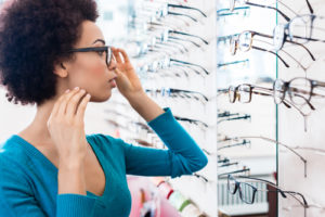 woman trying on glasses lenses