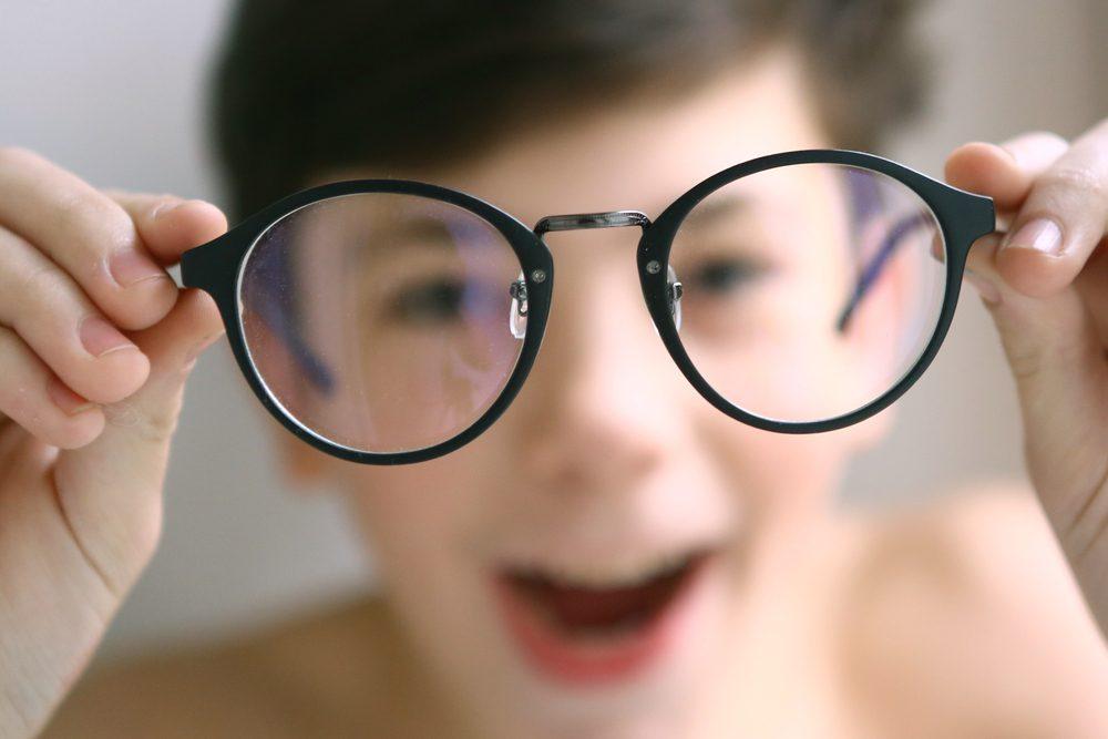 glasses held by boy