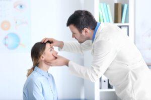woman getting eye examined at optometrist